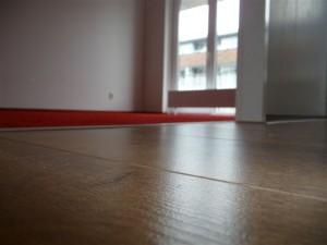 Koja woningstoffeerbedrijf - combinatie tapijt en laminaat vloer 2